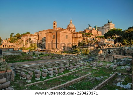 The Roman Forum is a rectangular forum (plaza) surrounded by the ruins of several important ancient government buildings at the center of the city of Rome. - stock photo