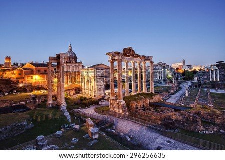 The Roman Forum photographed at sunset, with artificial lights on. - stock photo