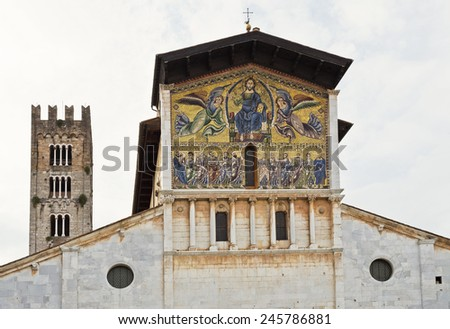 The Romanesque Basilica of San Frediano and the golden 13th century mosaic representing The Ascension of Christ the Saviour with the apostles below. - stock photo
