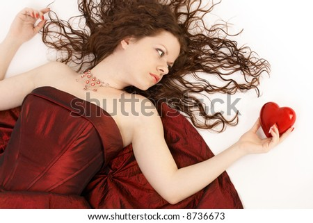 The romantic girl with heart in a hand - stock photo