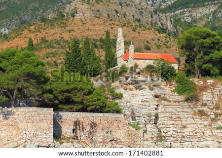 The roof and tower of orthodox monastery from the Adriatic sea area - stock photo