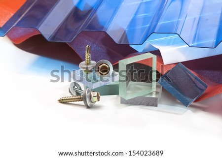 The roof is made �¢??�¢??of polycarbonate in different colors and shapes, screws for mounting on a white background - stock photo