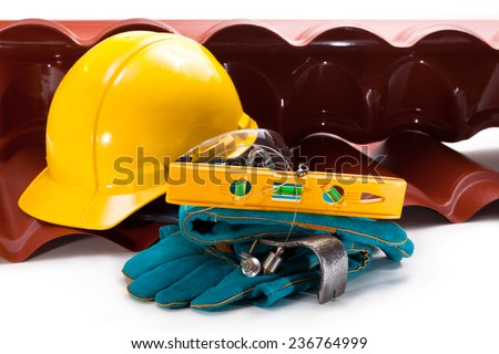 The roof is made of polycarbonate, level, gloves, helmet and screws for mounting - stock photo