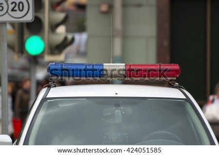 The roof-mounted lightbar of an emergency vehicle