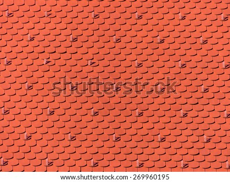 the roof of an old building  was newly renovated. new roof tiles on house - stock photo