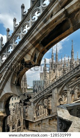 The roof of Milan Cathedral (or Duomo di Milano). Construction began in 1386, but it ended only in 1813. - stock photo