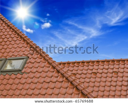 the roof of the house under the blue sky - stock photo