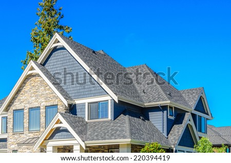 the roof of the house with nice window - stock photo