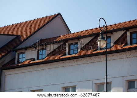 The roof, windows, lights against the sky