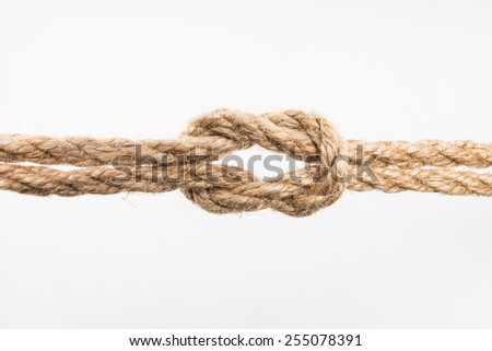 The rope knot on white background - stock photo