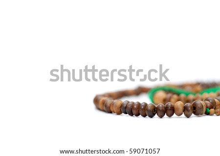the rosary beads on white background