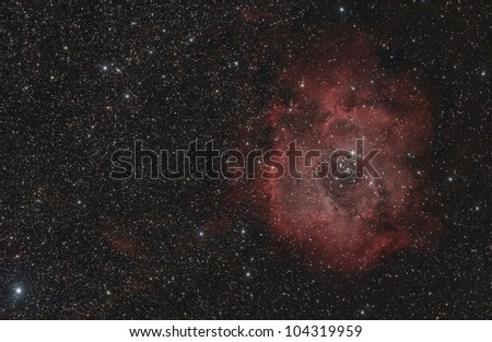 The Rosette Nebula (also known as Caldwell 49) is a large, circular H II region located near one end of a giant molecular cloud in the Monoceros region of the Milky Way Galaxy.