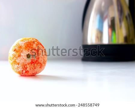 The rotten mandarin. - stock photo