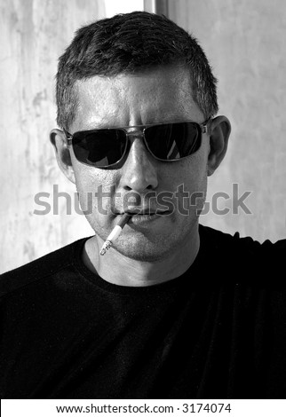 The rough sexual unshaven macho with a cigarette