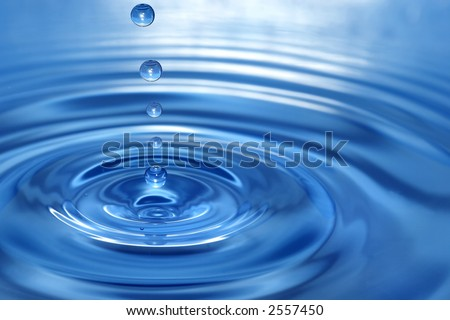 The round transparent drop of water, falls downwards... - stock photo