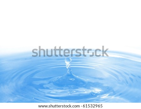 The round transparent drop of water falls downwards