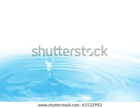 The round transparent drop of water falls downwards - stock photo