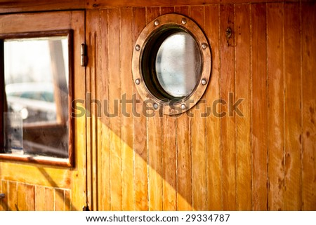 the round window an a boat - stock photo