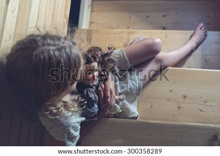 The row home - depressed little girl - stock photo
