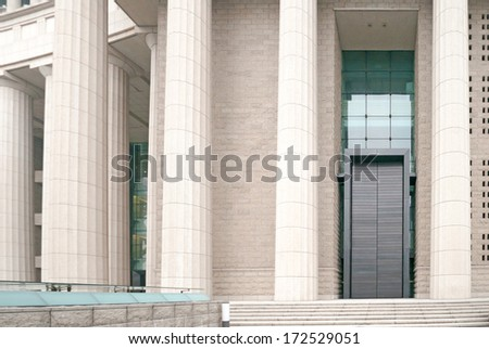 The row of classical columns with steps - stock photo