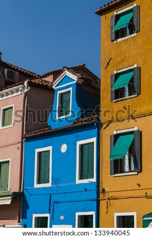 The row of colorful houses in Burano street, Italy.
