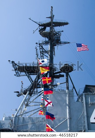 The row of flags found on the USS Midway Aircraft Carrier. - stock photo