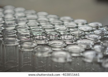 the row of glass scowl emtry - stock photo