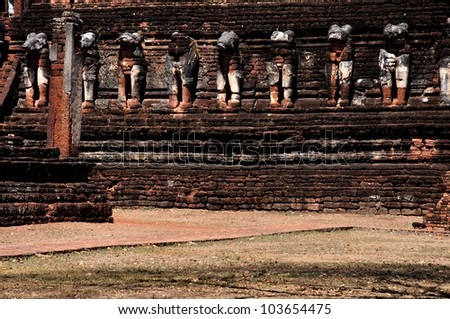 The row of old elephant around pagoda. - stock photo