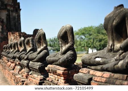The row of ruin Buddha wat chaiwatthanaram thailand - stock photo