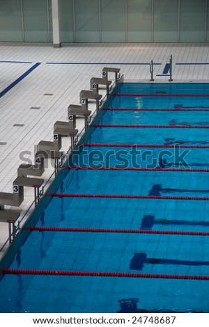 the row of starting blocks of a swimming pool olympic size