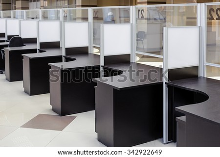 the row of tables in a modern office, customer service - stock photo