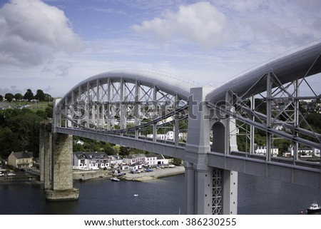 The Royal Albert Bridge. Saltash, Cornwall on a summers day. Blue sky with clouds.