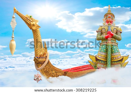 The Royal Barge Suphannahong with Giant guardian wat phra kaew grand palace  flying on the clouds bangkok, thailand travel thailand concept - stock photo