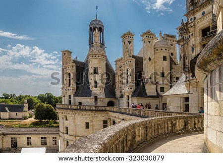 THE ROYAL CASTLE OF CHAMBORD, FRANCE - JUL 16, 2015: Tourists visiting the Chateau de Chambord, allegedly designed by Leonardo da Vinci