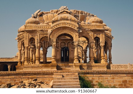 The royal cenotaphs of historic rulers at Bada Bagh in Jaisalmer made of yellow sandstone. - stock photo