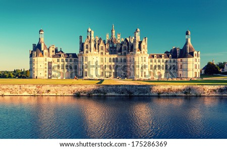The royal Chateau de Chambord, France. This castle is located in the Loire Valley, was built in the 16th century and is one of the most recognizable chateaux in the world. Vintage photo. - stock photo