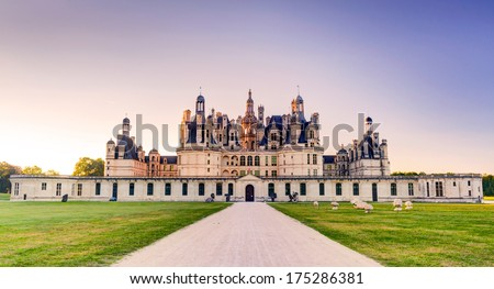 The royal Chateau de Chambord in the evening, France. This castle is located in the Loire Valley, was built in the 16th century and is one of the most recognizable chateaux in the world. - stock photo