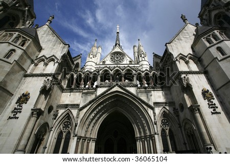 the royal courts of justice in the strand, london. - stock photo