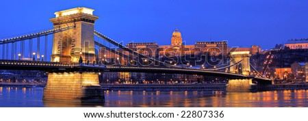 The Royal palace of Buda and the Chain Bridge in Budapest, Hungary by night - stock photo