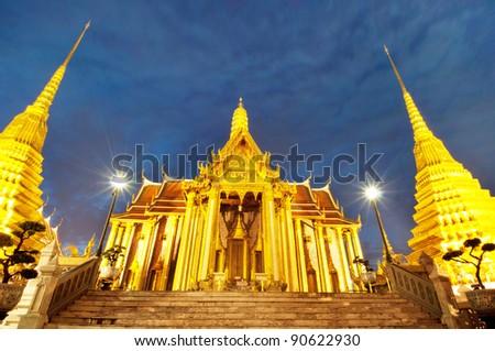 The Royal Pantheon at Wat Phra Kaew in Bangkok, home of the Emerald Buddha, at night - stock photo