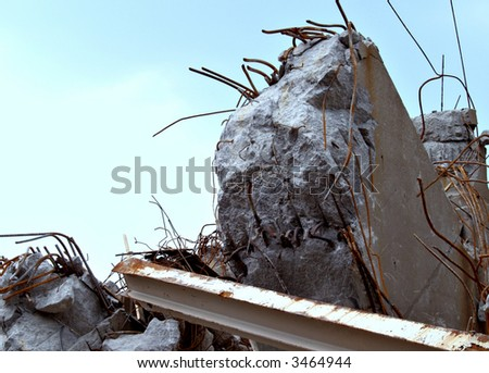 The rubble, debris, and twisted metal of a collapsed bridge - stock photo
