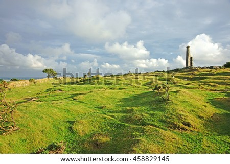 The rugged beauty of Bodmin Moor and late evening sun light and a distant view of the ruins of Craddock Moor engine house, Cornwall, England, UK