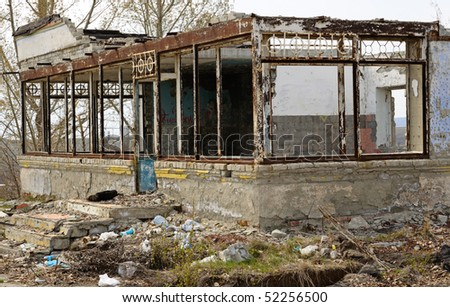 The ruin of an old house.  Destroyed structure. - stock photo