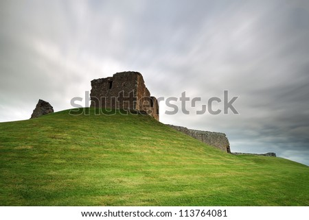 The ruin of Duffus Castle perched on a grassy mound. Near Elgin, Moray, Scotland