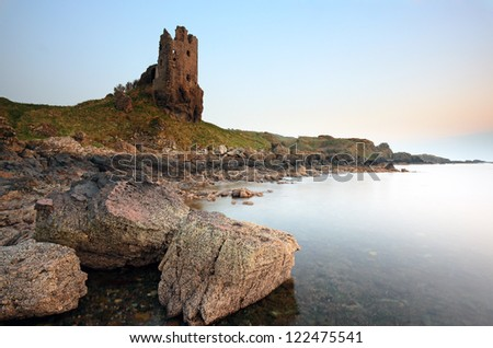 The ruin of Dunure Castle on the Ayrshire coast at Sunset. - stock photo