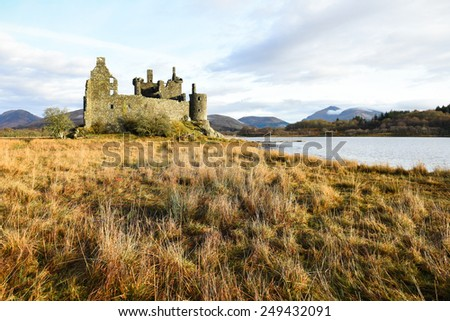 The ruin of Kilchurn Castle, Highland mountains and Loch Awe, Scotland - stock photo