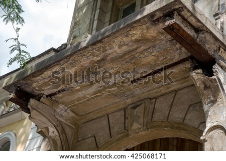The ruined facade of a historic building. Destroyed monuments. Old facade. Architectural detail of the damage to the outside of the castle facade. Historic ruins - stock photo