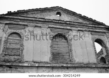 The ruins of a synagogue in Stolin, Belarus. Black and white. - stock photo