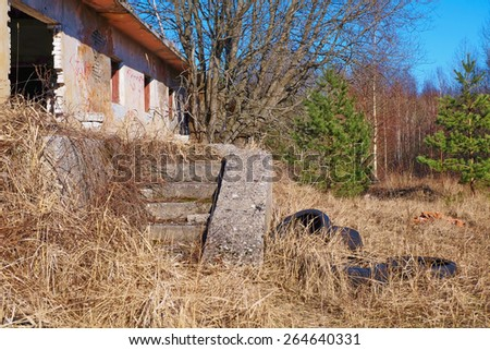 The ruins of an abandoned house with staircase collapsed - stock photo