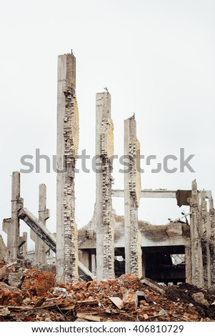 the ruins of an abandoned Soviet Russian industrial Damaged factory. The concept of system failure. - stock photo